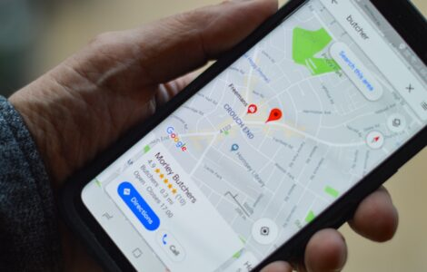 Person holding iPhone with Local SEO Google map image Google My Business profile